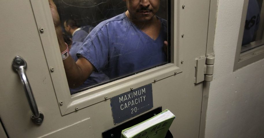 A man stands in a holding cell at the U.S. Immigration and Customs Enforcement detention facility for illegal immigrants in Florence, Arizona, on July 30, 2010. (John Moore / Getty Images)