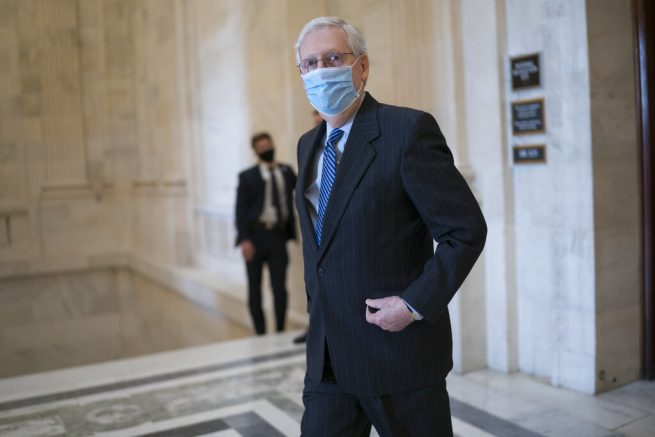 Senate Minority Leader Mitch McConnell, R-Ky., leaves a Republican policy luncheon on Capitol Hill in Washington, Thursday, March 4, 2021. (AP Photo/J. Scott Applewhite) Sen. Ron Johnson, R-Wis., Sen. Mike Lee, R-Utah,